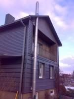 kaminas įmontuotas į namą